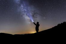 Silhouette Of A Man Under The Starry Sky
