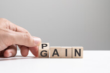No Pain No Gain Concept, Hand Flip Wood Cube Change The Word From Pain To Gain