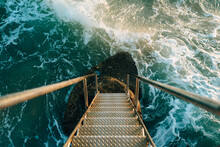 Waves At Bottom Of Ladder To Sea