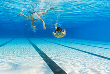 Two Kids Swimming In The Water