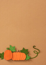 Pumpkins With Leaves On A Green Background.