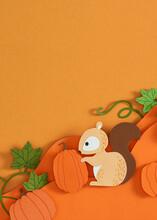 Closeup Of A Squirrel Stealing A Miniature Pumpkin