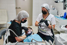 Dentist Drills A Patient's Tooth