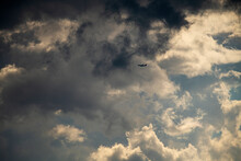 A Passenger Jet Takes Off Into Stormy Clouds.