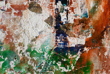 Decayed Concrete Wall With Orange And Green Paint