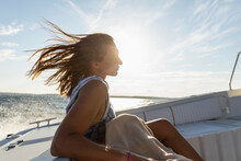 Woman On Boat Relaxing
