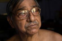 Headshot Portrait Of A Senior Citizen Inside Room