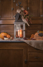 Rustic Farm House Autumn, Fall, Thanksgiving Background With Pumpkins, Leaves, And Lantern.