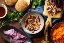 Slow Roasted Pulled Pork With Barbecue Sauce And Pickled Vegetables And Buns