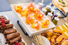 Glasses With Refreshing Fruit Salad Made With Assorted Colorful Fruits Served On Tray With Ice