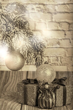 Sepia Pine Branch With Christmas Tree Decorations And Gifts