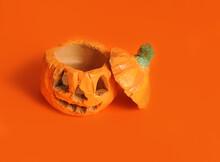 Hand Made Halloween Pumpkins On Orange Background.