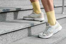 Man Walking Up The Stairs Outdoors
