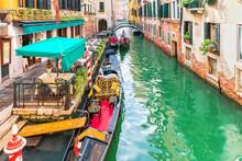 Gondola Moored In A Narrow Street Canal Of Venice, Italy