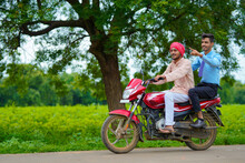 Indian Agronomist Going Agriculture Field With Farmer On Bike.