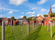 Wooden Huts And Fishing Nets At The Port Of Fishing Village Nysted, Lolland, Denmark