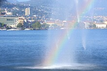 Rainbow Near The Fountain Over The Lake Near The City Of Lugano Switzerland