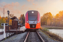 Highspeed Train Stands By The Wooden Platform At Sunset. Sortavala. Republic Of Karelia.