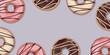 Pączki na jasnym tle. Pyszne ciastka z kolorową polewą. Tło dla dla piekarni, cukierni, kawiarni, ilustracja do social media, na menu, baner, ulotki, plakat, tapeta, kartki.
