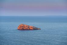 Rocky Isolated Islet In Sea At Sunrise. Benidorm Island, Alicante, Spain