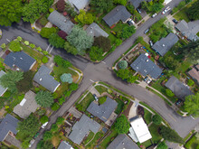 Small Town, Residential Neighborhood. A Lot Of Greenery. Asphalt Roadways, Footpaths. There Are No People In The Photo. Beautiful Scenery. Top View. Aerial View.