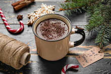 Cup Of Tasty Hot Chocolate, Rope And Tag LET IT SNOW On Black Wooden Background