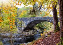 The Old Stonebridge Over The River Moriston At The Invermoriston Falls During Golden Autumn Time, Highlands, Scotland