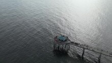 Aerial Of Okaloosa Island Fishing Pier Over Tranquil Ocean Near Fort Walton Beach In Florida, United States. Drone