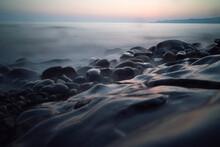 Pebble Coast Of The Black Sea In The Sunset Light