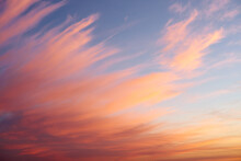 Beautiful Sunset Sky Background With Fiery Clouds. Colorful Sunset Sky With Yellow, Orange, And Pink Color