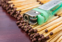 A Pocket Lighter Rests On Simple Matches