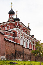 Brick Wall And Church Of Our Lady Of Kazan In Rozhdestvensky Convent (Convent Of Nativity Of Theotokos) On Rozhdestvenskiy Boulevard Of Moscow City