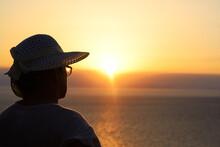 A Woman Watching The Sunset. Santorini, Oia, Greece.
