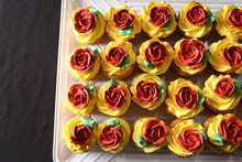 Yellow Flowers Cupcakes Black Background