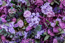 Artificial Purple Bouquet With A Variety Of Colors. Roses, Hydrangeas, Leaves, Orchids. Background Of Flowers