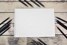 Empty Notebook With Black Colorul Pencils