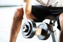 Man Lifting Weights, Closeup Shot