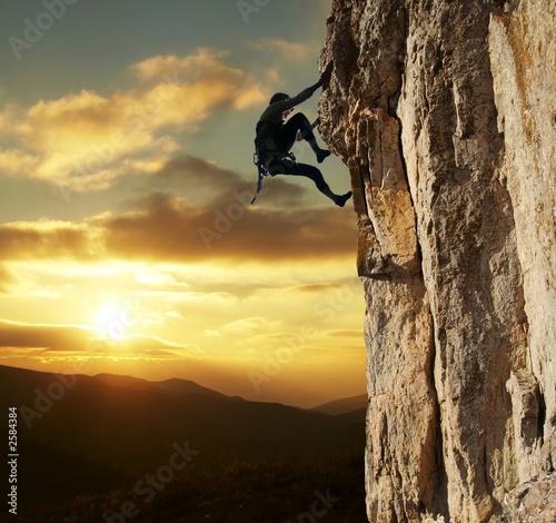 Obraz na płótnie climber on sunset