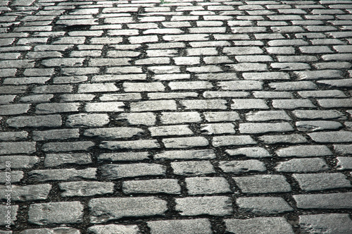 Cuadros en Lienzo Cobbles on the street - can be used as background