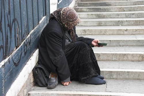 Bettlerin in Venedig Fototapet