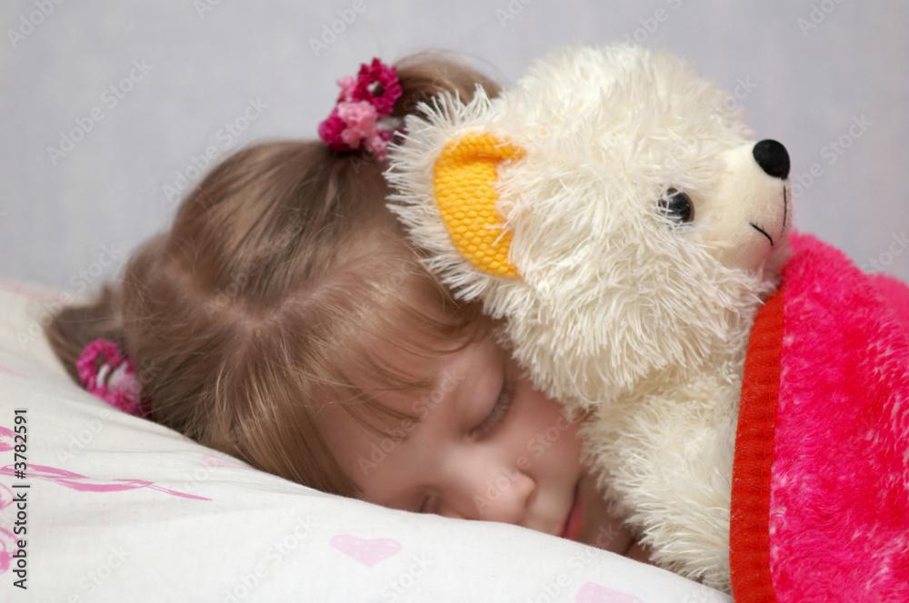 Obraz A little girl sleeping with a toy j fototapeta, plakat