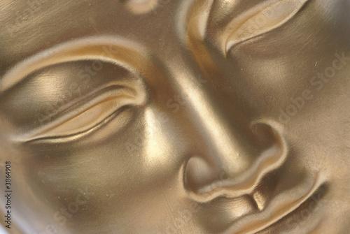 Stampa su Tela Diagonal close up of golden buddha face.