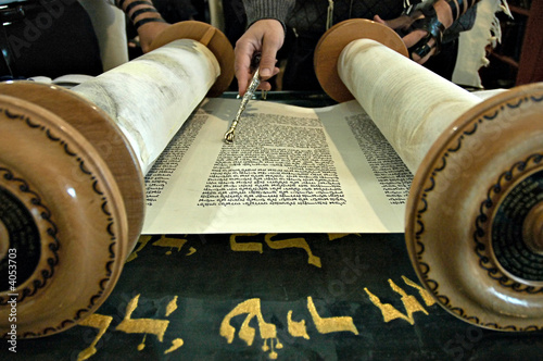 Torah  in a synagogue with a hand holding a silver pointer Fototapeta