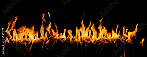 Tongues of fire in a panoramic view over a black background. #5901301
