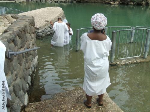 Fototapeta People baptizing in Jordan River in Israel