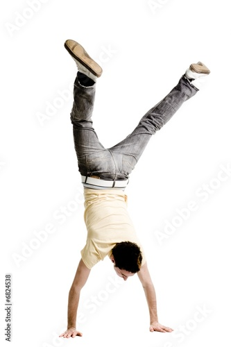 Fotografiet Young adult male doing a handstand on a white background
