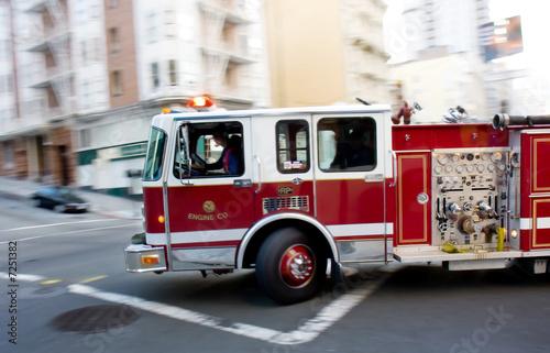Fototapeta Fire Engine in a Big City