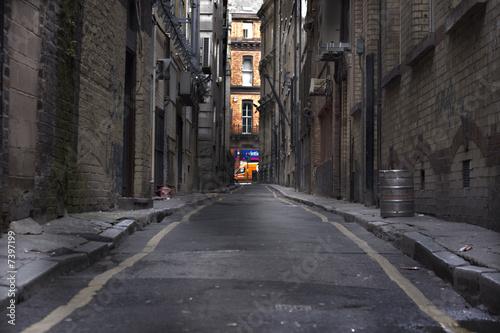 Murais de parede Looking down a long dark back alley