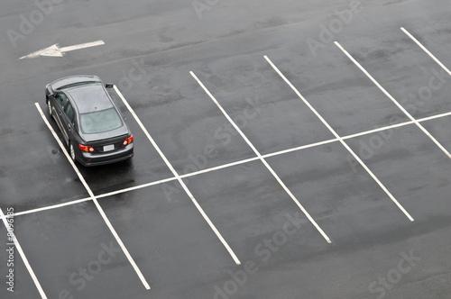 Fotografie, Obraz Single car in empty parking lot