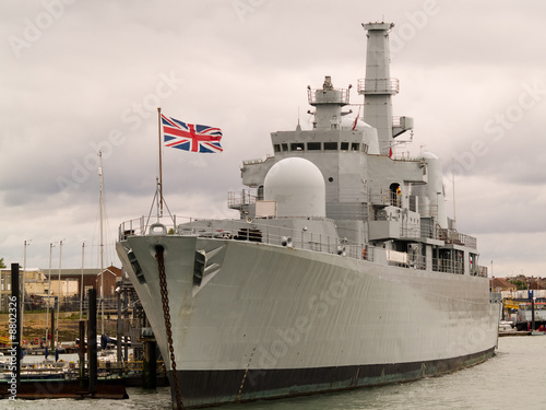 Canvas Print British war ship tied alongside.